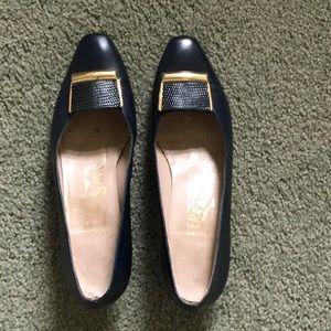 Used pair classic Ferragamo size 6B navy.